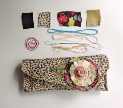 leopard clutch and elements
